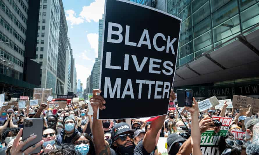 A man holds up a 'Black Lives Matter' sign during a demonstration in New York City on 7 June 2020.