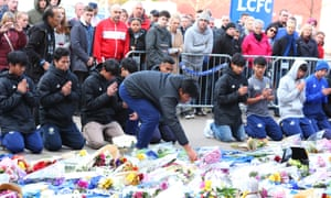 Fox Hunt football academy players pray on Sunday.