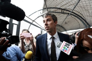 Beto O'Rourke is surrounded by reporters as he walks on a bridge to cross into Ciudad Juarez, Mexico.