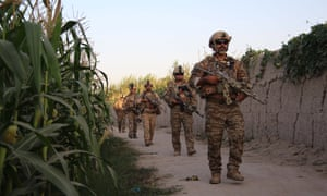 Afghan security officials patrol, during an operation against the Taliban militants, in Nad-e-Ali district of Helmand province last month.