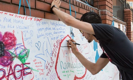 Wellwishers write on a banner outside Finsbury Park mosque after the attack on Monday.