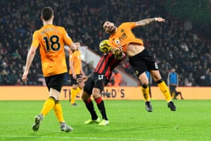 Bournemouth's Callum Wilson battles with Ruben Neves of Wolves at the Vitality Stadium. The visitors unbeaten league run to eight games as Wolves won 2-1, their longest such streak in 35 years.