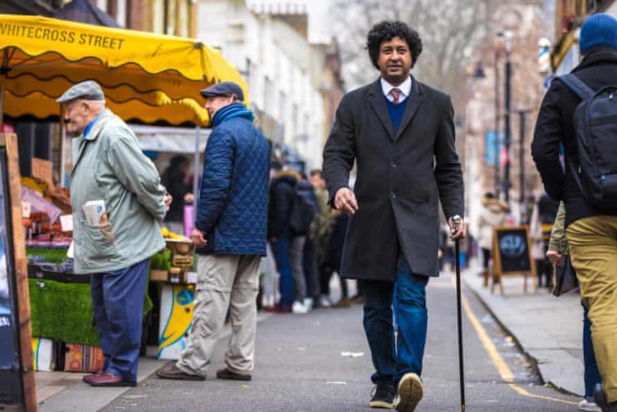 Niru Ratnam and cane at Whitecross Street market in east London