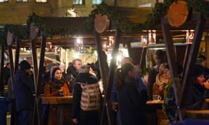 Stalls at the Lucia Christmas market in the Kulturbrauerei complex open for business in Berlin on 20 December.