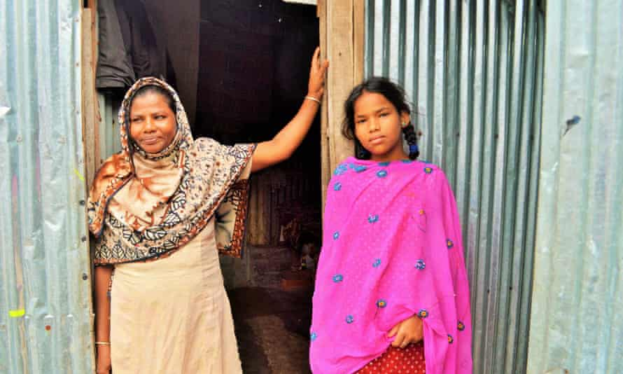 Parul Akter and her daughter in Dhaka's Korail slum.