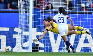 Christiane Endler pushes a close-range header from Christen Press round the post