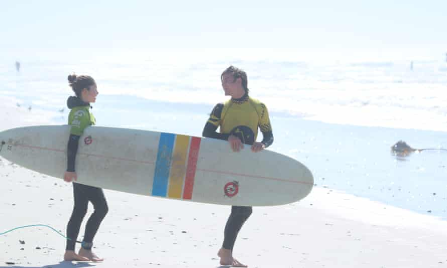 Jane, on the left, heading for the waves in Muizenberg