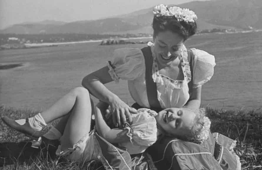 Actress Joan Crawford and her daughter, Christina, playing together in April 1945