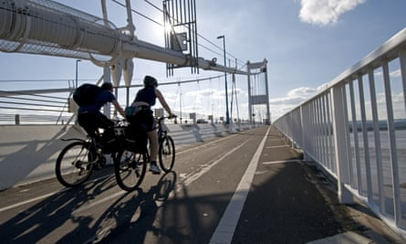 Two people cycle on the National Cycle Network.