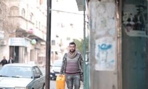Khaled al-Nairab collecting fresh water.