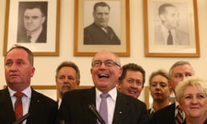 Nationals leader Warren Truss flanked by MPs in their party room