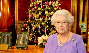 Mind your head. The Queen delivers her 2014 Christmas message from the state dining room in Buckingham Palace.