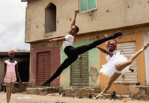 Anthony Madu leaps on a street on the outskirts of Lagos