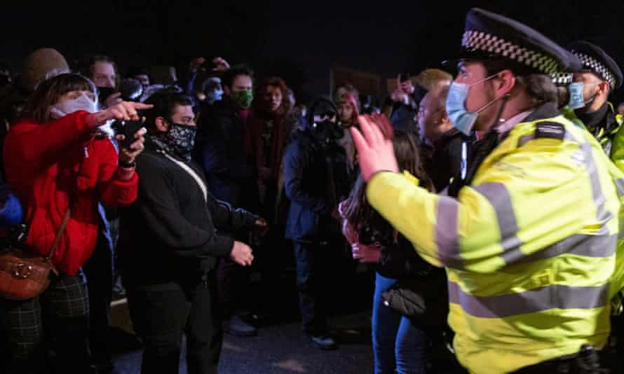 Police confront people attending the Sarah Everard vigil at Clapham Common on Saturday