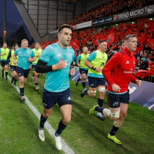 Conor Murray (left) and Chris Farrell lead a group of Munster players as they do a half lap of the pitch to finish their warmup.