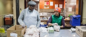 Lawrence, right, and Haydeth Tavera, left, distribute chickens at the West Side Campaign Against Hunger on Monday morning. Tavern has worked for the organization for 11 years: five as a volunteer and six as a staff member, after being a dependent on food from West Side Campaign Against Hunger herself.