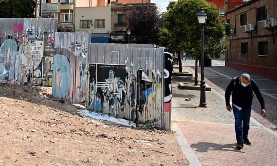 A man walks in the neighbourhood of Vallecas in Madrid.