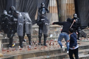 Protesters clash with riot police in Bolivar Square, Bogotá