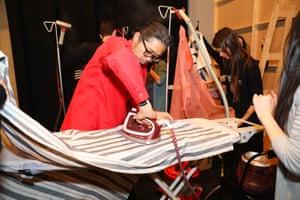 Akira Isogawa ironing clothes backstage at his show, Arika, at fashion week.