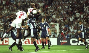 Sol Campbell (left) of England rises to head the ball into the back of the Argentina net, but the goal is disallowed for Alan Shearer's elbow on goalkeeper Carlos Roa.