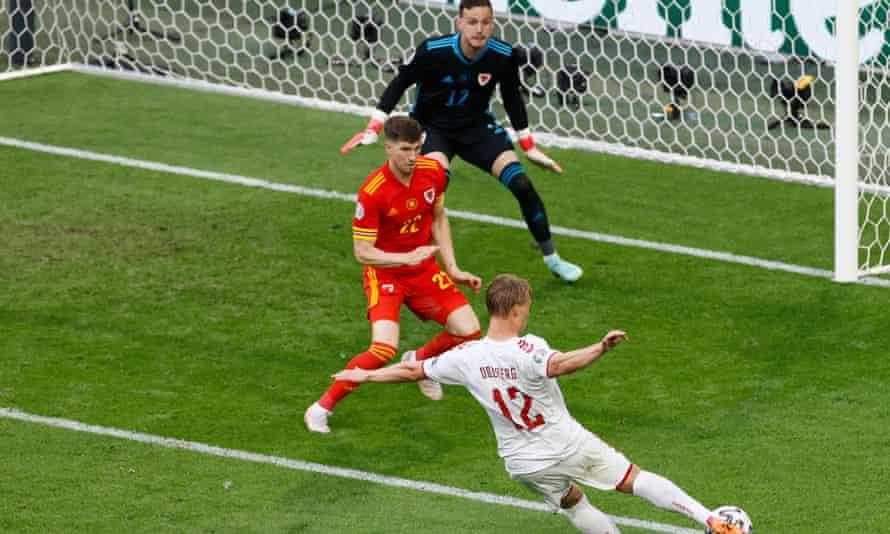 Denmark's Kasper Dolberg fires in his second goal against Wales.