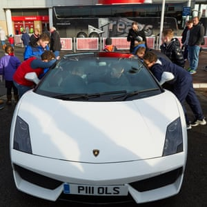 Fans looking at the Lamborghini Gallardo 560-4 which transported Middlesbrough fan Mackenzie Middleton to the Riverside and was hired by his mum Gemma as a 12th birthday treat.