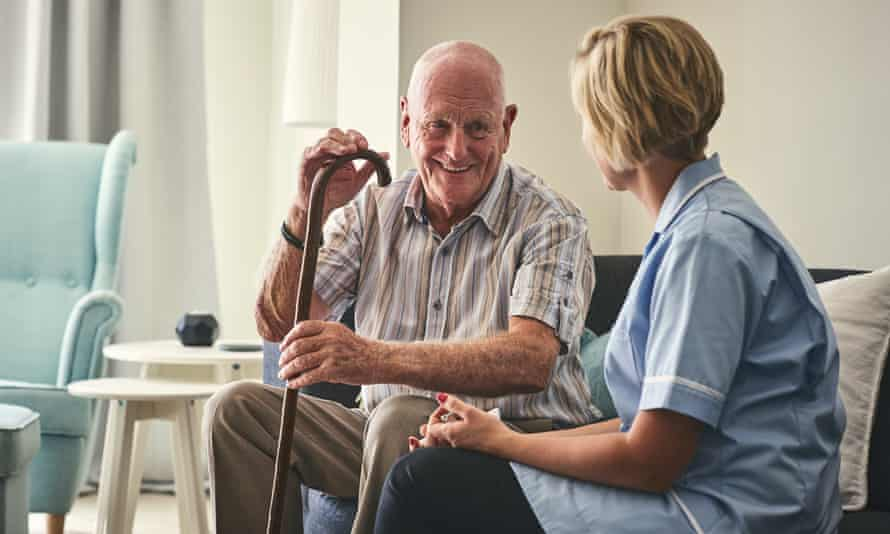 Smiling man with home carer