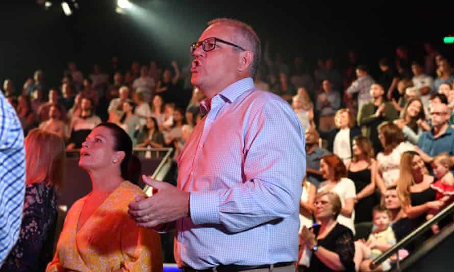 Australian prime minister Scott Morrison and wife Jenny sing during a service at Horizon church at Sutherland in Sydney, Australia