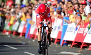 Chris Froome crosses the line to win the 16th stage.
