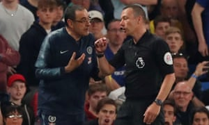 Referee Kevin Friend (right) sent Maurizio Sarri to the stands during a bad-tempered end to Chelsea's 2-2 draw with Burnley. Chelsea staff spoke to the referee post-match.