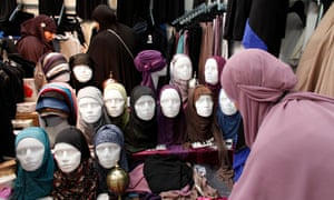Woman looking at headscarves at muslim trade fair