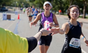 A marathon runner reaches for an energy gel