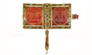 The prayer book has an enamelled gold cover and is studded with rubies, turquoise and tourmaline.