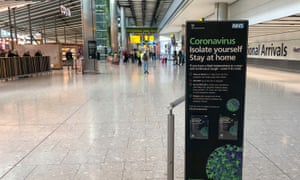 A sign in the empty arrivals area at Heathrow Terminal 5