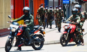 Soldiers patrol along a street in Colombo during the nationwide lockdown in Sri Lanka
