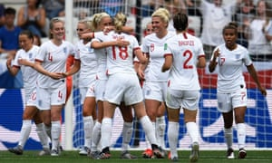 England's forward Ellen White (C) celebrates with teammates after scoring the second goal