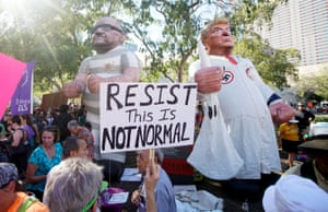Peace activists display a large balloon effigy of Donald Trump and former sheriff of Maricopa county Joe Arpaio during protests