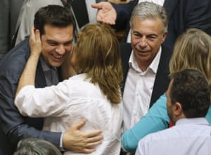 Greek Prime Minister Alexis Tsipras is congratulated by a lawmaker after a voting session at the Parliament in Athens<br>Greek Prime Minister Alexis Tsipras (L) is congratulated by a lawmaker after a voting session at the Parliament in Athens, Greece, July 11, 2015. The Greek parliament voted overwhelmingly on Saturday in favour of authorizing the left-wing government of Tsipras to negotiate with international creditors on the basis of a reform programme unveiled this week. REUTERS/Christian Hartmann TPX IMAGES OF THE DAY