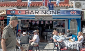 British expats and tourists at an English bar in Benalmádena, Spain