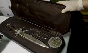 A knife with Nazi markings is seen at the Interpol headquarters in Buenos Aires, Argentina.