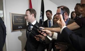The Facebook CEO, Mark Zuckerberg, arrives on Capitol Hill in Washington on Monday.