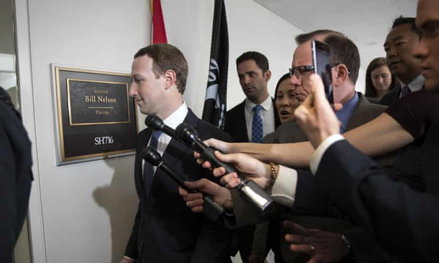 The Facebook CEO, Mark Zuckerberg, arrives on Capitol Hill in Washington on Monday.