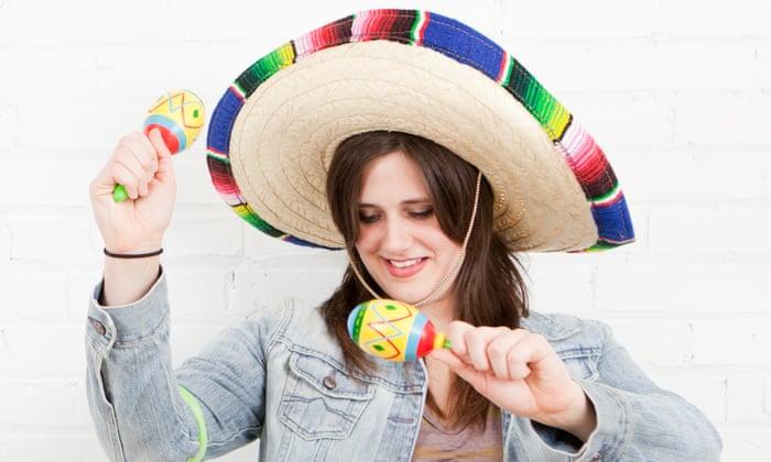 Studio Shot of young woman dancing in sombrero