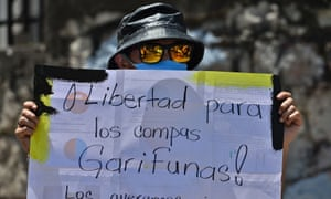 A member of the Garifuna ethnic group takes part in a protest in front of the supreme court in Honduras.