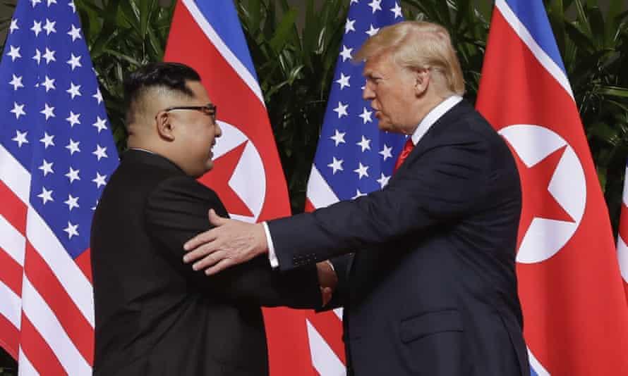 Donald Trump shakes hands with North Korea leader Kim Jong-un at the Singapore summit