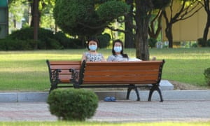 Students wearing face masks are seen in campus of a university which has been shut down in Pyeongtaek, South Korea.