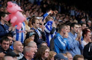 It's not going well for the home side, so a dejected Wednesday fan gets out his blow up pig (both sides call each other Pigs).