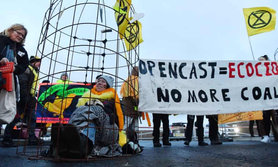Activists from the Extinction Rebellion climate action group gather to block the entrance to the Bradley opencast coal mine in the Pont Valley in County Durham.