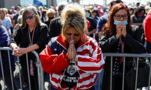People pray for Trump