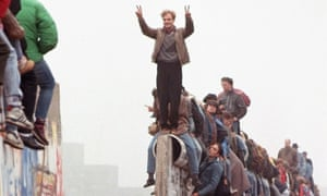 'We made history' … celebrations as East Germans flood through the falling Berlin Wall in 1989.